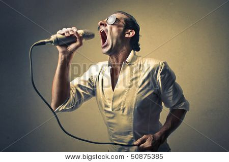 successful singer singing with the microphone