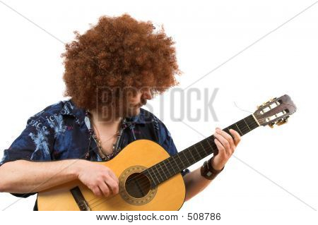 Old Hippie Playing On His Guitar