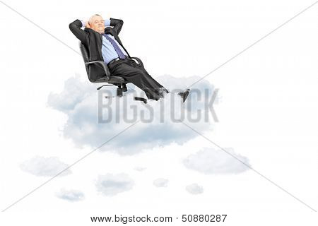 Mature businessman resting in armchair, floating on a cloud isolated on white background