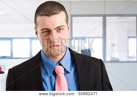 Portrait of a disgusted businessman
