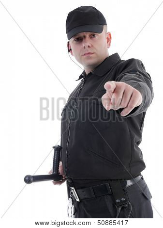 Policeman wearing black uniform pointing in ordering manner