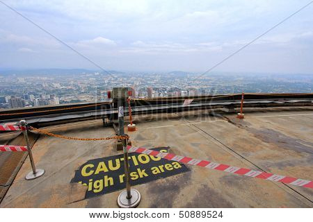MALAYSIA - AUGUST 11 : Observation Deck at the Kuala Lumpur Tower (Menara KL) on August 11, 2013. Tourists visit the open deck area of 421 meters high to have a 360 degree view of the city.