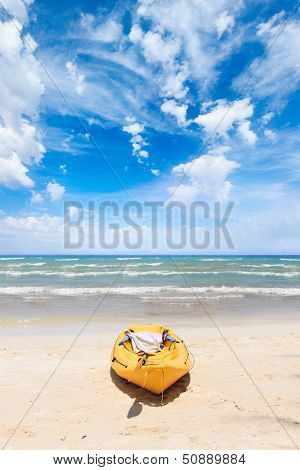 Tropical beach landscape with canoe boat at ocean gulf under blue sky. Ko Phi Phi Don, Thailand