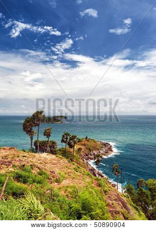 Promthep Cape Phuket viewpoint in Thailand. Andaman sea and white clouds on blue sky in Laem Phromthep