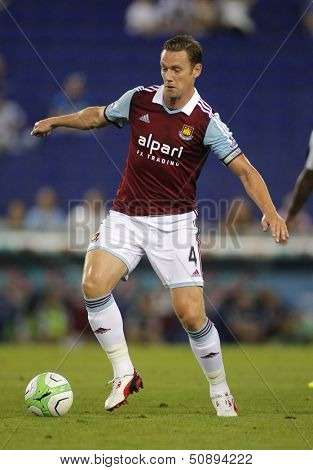BARCELONA - SEPT, 5: Kevin Nolan of West Ham United in action during before a friendly match against RCD Espanyol at the Estadi Cornella on September 5, 2013 in Barcelona, Spain