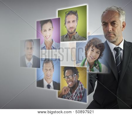 Mature human resources director selecting future employees on digital screens