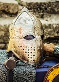 foto of templar  - Protective helmet with a visor on medieval knight - JPG