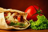 stock photo of shawarma  - still life with traditional shawarma closeup and fresh vegetables - JPG