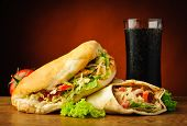 stock photo of kebab  - still life with traditional turkish doner kebab shawarma and cola drink - JPG