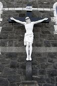 stock photo of crucifiction  - a cross of the crucifiction on the outside wall of a church in Donegal Ireland - JPG