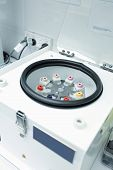 foto of centrifuge  - A centrifuge in the laboratory workroom of a pathology medical blood collection clinic - JPG
