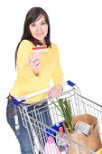 stock photo of grocery-shopping  - brunette woman with shopping cart - JPG