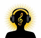 stock photo of clefs  - human silhouette in headphones with a treble clef on the background - JPG