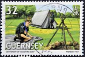 Guernsey - Circa 2007: A Stamp Printed In Guernsey Dedicated To Centenary Of Scouting, Circa 1999