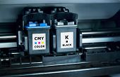 foto of dtp  - Black and color printer ink cartridges inside machine - JPG
