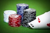 picture of ace spades  - Gambling chips ace of diamonds and king of spades on green poker cloth - JPG