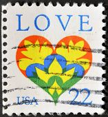 A stamp printed in the USA shows the word love and a love heart