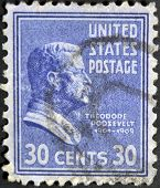 a stamp printed in the United States of America shows Theodore Roosevelt 26th President of USA