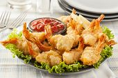 stock photo of shrimp  - Fried Organic Coconut Shrimp with Cocktail Sauce - JPG