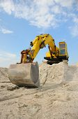 stock photo of dump-truck  - A powerful digger is parked at a building site - JPG