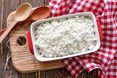stock photo of curd  - Cottage cheese in a bowl on a table - JPG