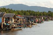 Traditional Thai fishing village along the river and the mangrove in Si Thammarat, Thailand