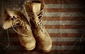 image of army  - US Army boots on the vintage textured paper flag background - JPG