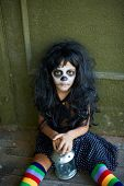 pic of antichrist  - Portrait of Halloween girl with lantern sitting on the floor of dilapidated house - JPG