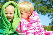 stock photo of snuggle  - Two happy young children - JPG
