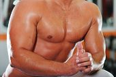 stock photo of execution  - Athletic strong bodybuilder - JPG