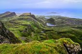 stock photo of landslide  - Scenic view of green Quiraing coastline in Scottish highlands 