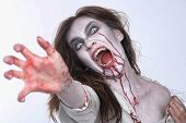 stock photo of possess  - Bleeding Psychotic Woman in a Horror Themed Image - JPG