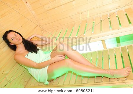 Pretty girl in the small sauna