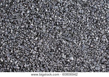 Shiny gravel texture, close up.