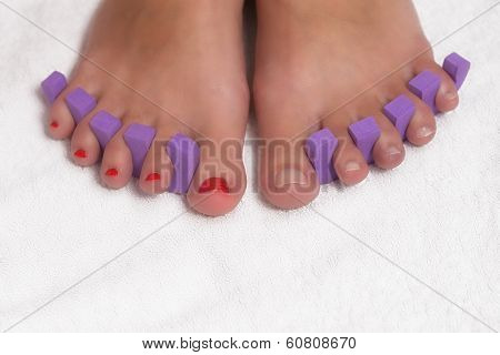 Feet Of A Woman With Red Varnish