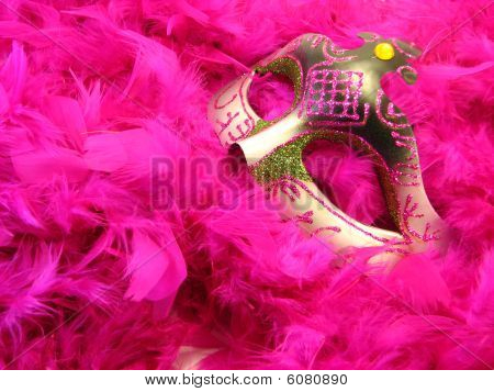 Halloween mask over feather boa scarf