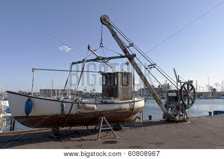 Small Fishing Boat On The Pier
