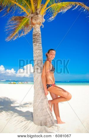 Girl by palm tree