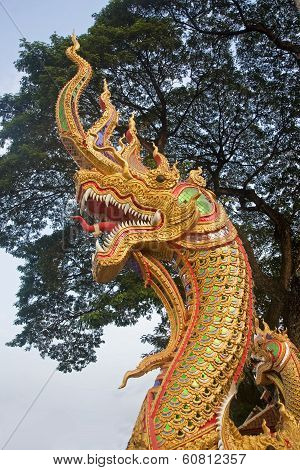 Head Of Golden Serpent Is A Common Decorative Element