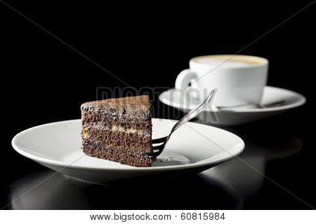 Slice Of Fresh Chocolate Cake Served With Coffee