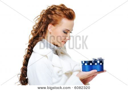 Woman In White Fur Coat With Blue Present Box