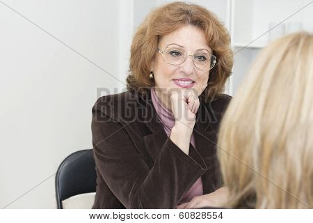 Mature Businesswoman With Client