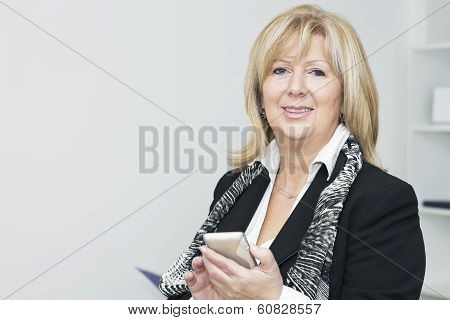 Mature Businesswoman With Smart Phone