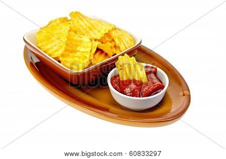 Chips In Tomato Sauce On A Clay Plate