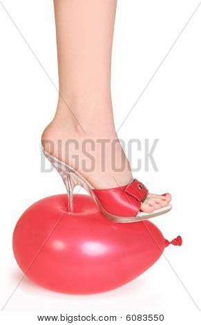 red balloon under spike heel