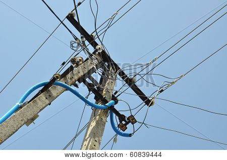 Electric pole with lines of cables