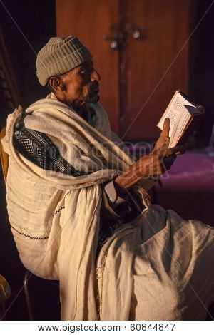 Orthodox Priest studies The Bible