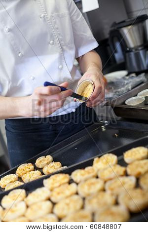 Chef Preparing Desserts Removing Them From Moulds