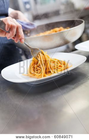 Chef Plating Up Seafood Pasta