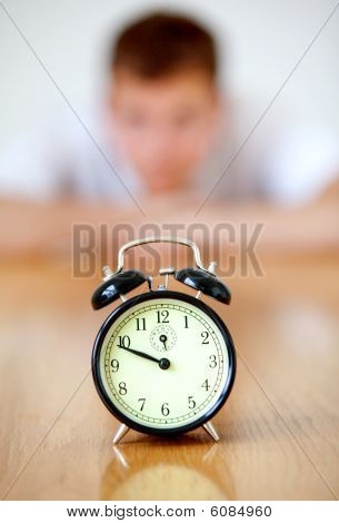 Man Staring At A Clock